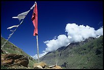 Prayer flag and cloud-capped peak, Himachal Pradesh. India