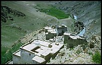 Terraced roofs of village above river valley, Zanskar, Jammu and Kashmir. India