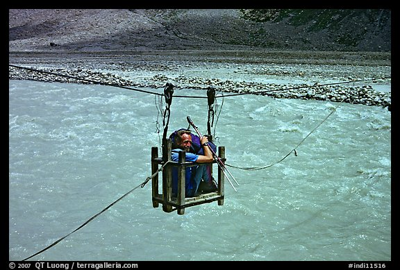 Trekker crossing a river by cable, Zanskar, Jammu and Kashmir. India