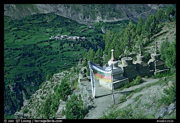 Prayer flag, chortens, and verdant valley below, Himachal Pradesh. India