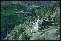 Prayer flag, chortens, and verdant valley below, Himachal Pradesh. India (color)