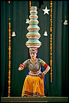 Rajasthani dancer balancing jars on head. New Delhi, India (color)
