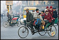 Cycle-rickshaw with a load of ten schoolchildren. New Delhi, India