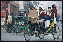 Cycle-rickshaw carrying uniformed schoolgirls. New Delhi, India (color)