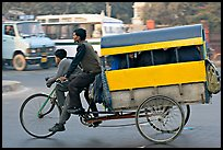 Cycle-rickshaw pulling a box for carrying schoolchildren. New Delhi, India