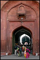People walking out of the Covered Bazar, Red Fort. New Delhi, India ( color)
