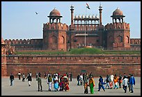 Visitors walking on esplanade in front of the Lahore Gate. New Delhi, India