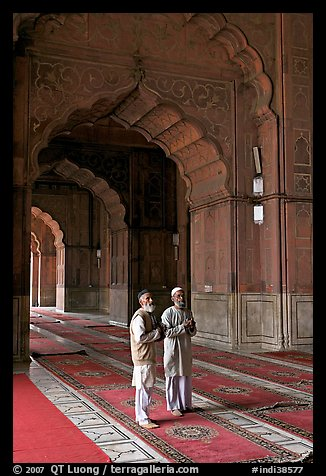 Two muslem men in Jama Masjid mosque prayer hall. New Delhi, India (color)