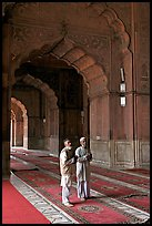Two muslem men in Jama Masjid mosque prayer hall. New Delhi, India