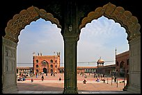 Courtyard of mosque seen through arches of prayer hall, Jama Masjid. New Delhi, India (color)
