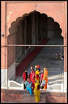Women standing beneath arched entrance of prayer hall, Jama Masjid. New Delhi, India ( color)
