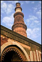 Alai Darweza gate and Qutb Minar tower. New Delhi, India (color)