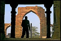 Man at entrance of ruined Quwwat-ul-Islam mosque. New Delhi, India ( color)