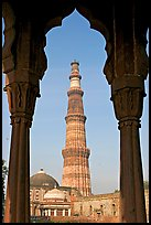 Qutb Minar tower framed by columns. New Delhi, India (color)