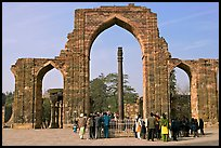 Iron pillar, and ruined mosque arch, Qutb complex. New Delhi, India (color)