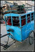 Schoolchildren in an enclosed  box towed by cycle. New Delhi, India (color)