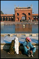Women sitting near basin in courtyard of Jama Masjid. New Delhi, India ( color)