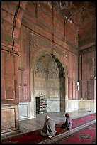 Muslim men praying, prayer hall, Jama Masjid. New Delhi, India