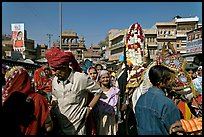 Groom covered in flowers and riding horse during Muslim wedding. Jodhpur, Rajasthan, India