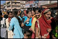 Young women during a wedding procession. Jodhpur, Rajasthan, India (color)