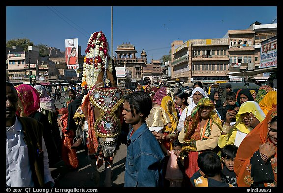 Wedding procession with flower-covered groom on horse. Jodhpur, Rajasthan, India