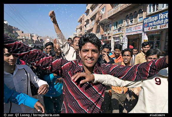 Young men celebrating during wedding procession. Jodhpur, Rajasthan, India (color)