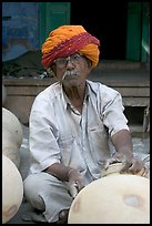 Man with turban holding a jar. Jodhpur, Rajasthan, India