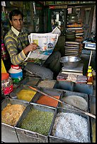 Man with newspaper selling grains, Sardar Market. Jodhpur, Rajasthan, India