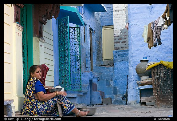 Women sitting in alley painted with indigo tinge. Jodhpur, Rajasthan, India