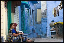 Women sitting in alley painted with indigo tinge. Jodhpur, Rajasthan, India ( color)