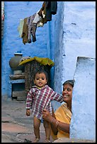 Baby girl and woman in blue alley. Jodhpur, Rajasthan, India (color)