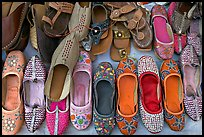 Embroidered mojris (traditional Jodhpur shoes) for sale. Jodhpur, Rajasthan, India (color)