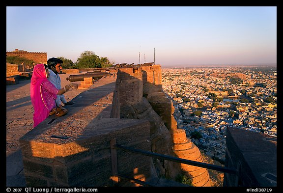 Couple looking at the view from Mehrangarh Fort. Jodhpur, Rajasthan, India (color)