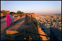 Couple looking at the view from Mehrangarh Fort. Jodhpur, Rajasthan, India ( color)