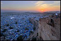 Mehrangarh Fort walls, blue houses, and setting sun. Jodhpur, Rajasthan, India