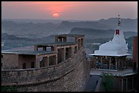 Sun setting over the Chamunda Devi temple, Mehrangarh Fort. Jodhpur, Rajasthan, India (color)