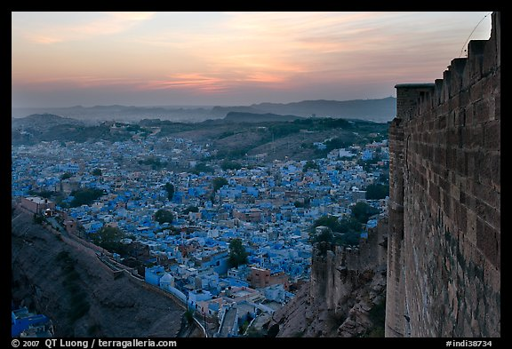 Mehrangarh Fort walls, and old city  blue houses, sunset. Jodhpur, Rajasthan, India (color)