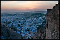 Mehrangarh Fort walls, and old city  blue houses, sunset. Jodhpur, Rajasthan, India ( color)