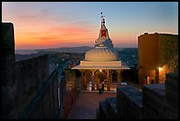 Chamunda Devi temple with man worshipping at sunset, Mehrangarh Fort. Jodhpur, Rajasthan, India