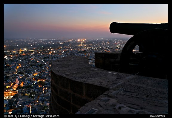 Cannon on top of Mehrangarh Fort, and city lights below. Jodhpur, Rajasthan, India