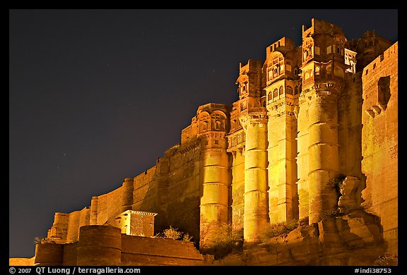 Towers and 36m high walls of Mehrangarh Fort by night. Jodhpur, Rajasthan, India
