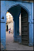 Archway with woman carrying water in courtyard. Jodhpur, Rajasthan, India (color)