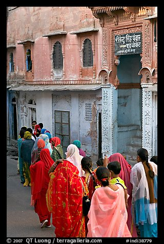 Women walking in a narrow old town street. Jodhpur, Rajasthan, India (color)