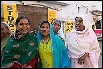 Women wearing hijabs smiling in the street. Jodhpur, Rajasthan, India (color)