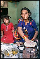 Woman and girl preparing chapati bread. Jodhpur, Rajasthan, India (color)