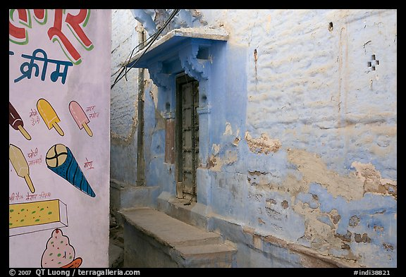 Whitewashed walls with indigo tint and ice-cream depictions. Jodhpur, Rajasthan, India (color)