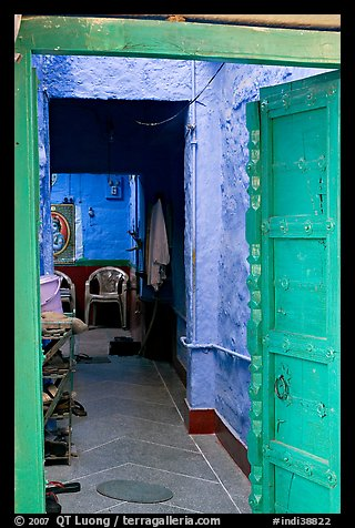 Doorway and inside of a house painted blue. Jodhpur, Rajasthan, India (color)
