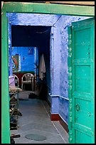 Doorway and inside of a house painted blue. Jodhpur, Rajasthan, India ( color)