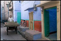 Man with vegetables car in front of painted house. Jodhpur, Rajasthan, India ( color)