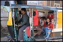 Rickshaw transporting schoolchildren. Jodhpur, Rajasthan, India (color)